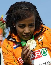 08-12-2013 ATHLETICS: SPAR EC CROSS COUNTRY: BELGRADE<br /> Sifan Hassan heeft vandaag haar favorietenrol waargemaakt. De atlete, die pas enkele weken geleden haar Nederlandse paspoort kreeg, won vandaag het EK Cross onder 23 jaar.<br /> ©2013-WWW.FOTOHOOGENDOORN.NL