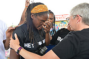 6/25/21 Minneapolis Minnesota <br /> Pictured Marcia Howard, left and Shari Seifert of Calvary Baptist Church, reacting to the sentencing of Derek Chauvin for the brutal murder of George Floyd. Chauvin was sentenced to 22.5 years and is the harshest sentence ever given a police officer in Minnesota. The local community has mixed emotions regarding the sentencing and feels that there is much work that still needs to be done. Samir Abumayyaleh, owner of Cup Foods where George Floyd was brutally murdered by Derek Chauvin, listens to the sentencing and talks to members of the local community.  Photo © Suzi Altman
