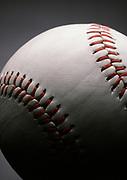 Dramatically lit close up of a major league baseball