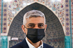 © Licensed to London News Pictures. 30/04/2021. London, UK. Sadiq Khan, Mayor of London, wearing a face covering at the London Islamic Cultural Society and Mosque, also known as Wightman Road Mosque in Haringey, north London. The Mayor of London and the devotees are two meters apart and keeping to the rules of social distancing. Muslims across the world are observing the holy fasting month of Ramadan, a month long celebration with prayers, readings from the Koran and meeting with family and friends, as they abstain from eating, drinking and smoking from dawn till dusk. Sadiq Khan is running for re-election as London Mayor. Photo credit: Dinendra Haria/LNP