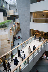 Interior of modern upmarket shopping mall at Mori Building in Roppongi Tokyo Japan