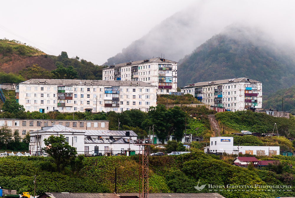 Russia, Sakhalin. Kholmsk is an important sea port for the island of Sakhalin. Old Soviet era apartment blocks.