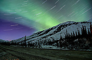 A spectacular display of northern lights over the Brooks Range along the Dalton Highway.