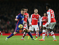 Arsenal's Alex Oxlade-Chamberlain tussles with Manchester United's Luke Shaw<br /> <br /> Barclays Premier League- Arsenal vs Manchester United - Emirates Stadium - England - 22nd November 2014 - Picture David Klein/Sportimage