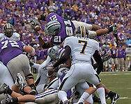 Kansas State running back Carlos Alsup (21) dives over the Missouri defense for the Wildcat touchdown, tying the game at 7-7 in the first quarter at Bill Snyder Family Stadium in Manhattan, Kansas, November 19, 2005.  K-State defeated the Missouri Tigers 36-28.