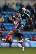 Rowan Liburd of Wycombe Wanderers jumps over Fraser Franks of Stevenage to head the ball. Skybet football league two match, Wycombe Wanderers  v Stevenage Town at Adams Park  in High Wycombe, Buckinghamshire on Saturday 12th March 2016.<br /> pic by John Patrick Fletcher, Andrew Orchard sports photography.