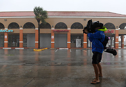 MIAMI, Sept. 10, 2017  A cameraman takes video among rain and strong winds as hurricane Irma arrives, in Miami, Florida, the United States, on Sept. 10, 2017.  Category Four Hurricane Irma on Sunday morning made landfall in the Florida Keys with gust wind speed of 171 km/h, according to the National Hurricane Center  (srb) (Credit Image: © Yin Bogu/Xinhua via ZUMA Wire)