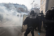 December, 8th, 2018 - Paris, Ile-de-France, France: Riot police in clouds of tear gas on Champs Elysees. The French 'Gilets Jaunes' demonstrate a fourth day. Their movement was born against French President Macron's high fuel increases. They have been joined en mass by students and trade unionists unhappy with Macron's policies. Nigel Dickinson