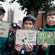 Three particpants in the march, Defenders of the Arctic spells out their demands to Shell. The giant polar bear puppet Aurora made by Greenpeace walked the streets of London in defence of the Arctic as part of a Greenpeace global day of action. The parade,part performance part protest, was to highlight the melting ice caps and the increasing and potentially devastating oil drilling in the arctic sea. Shell is one of the companies drilling and the march through London ended up outside Shell London HQ to draw attention to their oil business in the arctic. Aurora, the biggest polar bear in the world represents all endangered species in arctic.