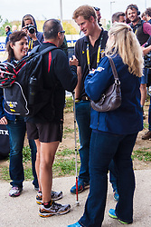 Queen Elizabeth Olympic Park, London. September 13th 2014. Prince Harry talks to a competitor as wounded servicemen and women from 13 different countries compete for sporting glory during the cycling competition at the Invictus Games.