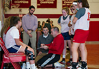 Coach Lahey checks the remaining time as Coach Greeley makes adjustments in play during a timeout in Monday nights scrimmage with Newfound.   (Karen Bobotas/for the Laconia Daily Sun)