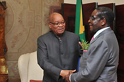 PRETORIA, June 10, 2011  Zimbabwean President Robert Mugabe (R) shakes hands with South African President Jacob Zuma in Pretoria, South Africa, June 10, 2011. Progress on a path to elections in Zimbabwe is expected to be discussed when Mugabe met his South African counterpart Jacob Zuma late on Friday, the Times newspaper in Johannesburg reported. (Credit Image: © Xinhua via ZUMA Wire)