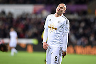 Jonjo Shelvey of Swansea city reacts after missing a goal chance. Barclays Premier league match, Swansea city v Queens Park Rangers at the Liberty stadium in Swansea, South Wales on Tuesday 2nd December 2014<br /> pic by Andrew Orchard, Andrew Orchard sports photography.