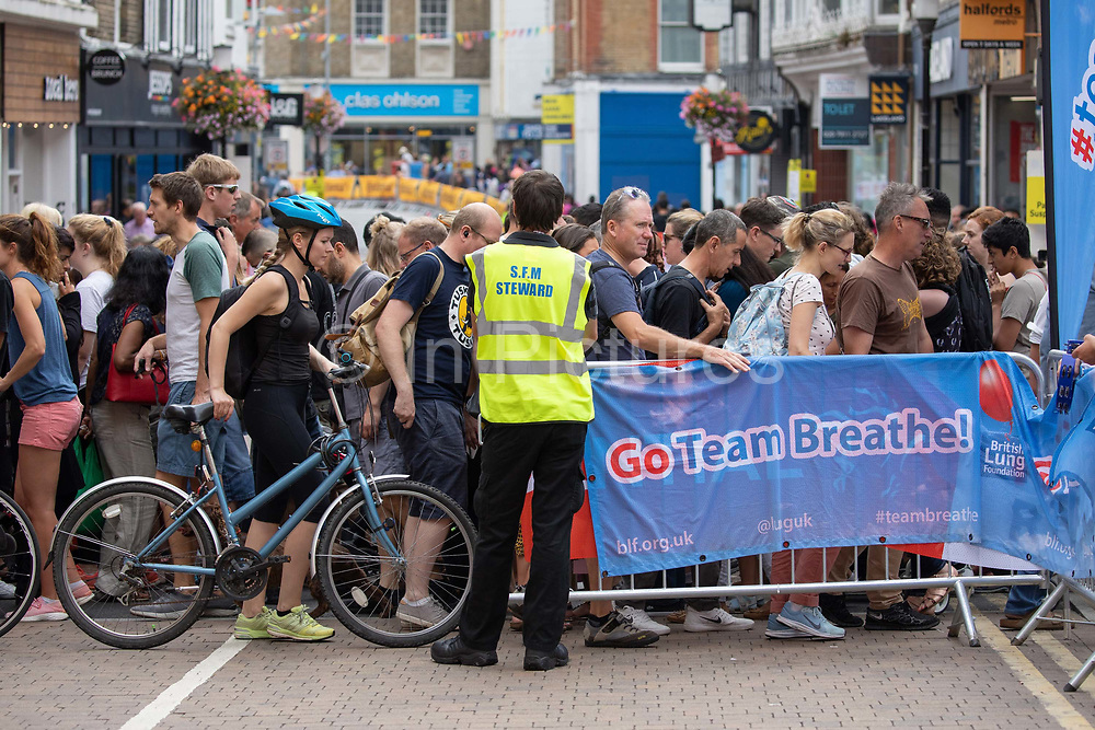 Pedestrians trying to reach Kingston high street temporarily block access for cyclists during the 7th Prudential RideLondon Surrey Classic on the 4th August 2019 in Kingston upon Thames in the United Kingdom.