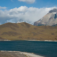 The Horns of Paine tower over one of the Mellizas Lakes in Torres del Paine National Park, Chile.