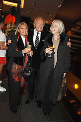 Left to right, MR & MRS HAROLD TILLMAN and HILARY RIVA Chief Executive of the British Fashion Council at a party hosted by Mulberry to celebrate the publication of The Meaning of Sunglasses by Hadley Freeman held at Mulberry 41-42 New Bond Street, London on 14th February 2008.<br /><br />NON EXCLUSIVE - WORLD RIGHTS