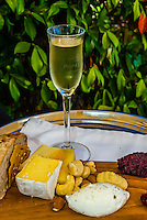 """Local cheese platter accompanied by Pierre Jordan Ratafia wine, the last of a six course """"Taste of Summer"""" lunch menu, restaurant at Haute Cabriere Vineyard Estate, Franschhoek Pass, Franschhoek, Cape Winelands, South Africa."""