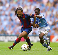 Photo. Jed Wee<br /> Manchester City v Barcelona, Pre-season Friendly, City of Manchester Stadium, Manchester. 10/08/2003.<br /> Barcelona's Ronaldino (L) holds off Manchester City's Shaun Wright-Phillips.