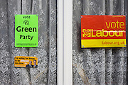 The three main British political parties Greens, Labour and Conservatives are displayed to a south London home's front window.