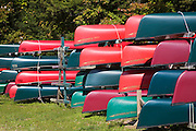 Red and green canoes in storage in Adirondack Mountains.
