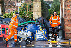 © Licensed to London News Pictures. 21/01/2021. York UK. Workmen place sandbags outside properties in York as the water level of the River Ouse in York city centre has continued to rise to a hight of 4.44m recorded at 08.45am this morning which is a metre higher than yesterday & is expected to continue rising. Photo credit: Andrew McCaren/LNP