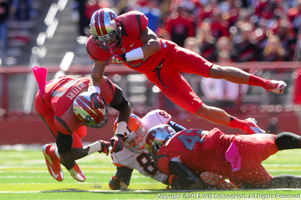 Oct 13, 2012: Syracuse Orange tight end Beckett Wales (85) is gang-tackled by Rutgers Scarlet Knights Lorenzo Waters (21), linebacker Steve Beauharnais (42) and defensive back Brandon Jones (25), during NCAA Big East college football action between the Rutgers Scarlet Knights and Syracuse Orange at High Point Solutions Stadium in Piscataway, N.J.