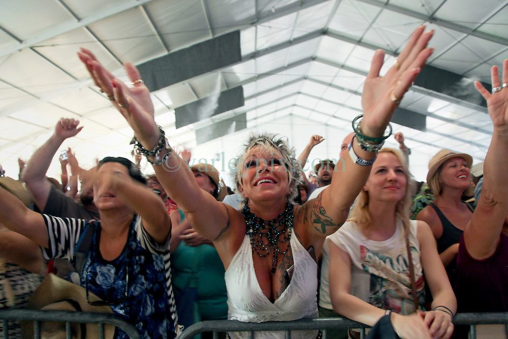 03 May 2015. New Orleans, Louisiana.<br /> The New Orleans Jazz and Heritage Festival. <br /> Fans celebrate Buddy Guy at the Blues Tent.<br /> Photo; Charlie Varley/varleypix.com