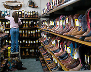 9/27/08 Valentine, NEB.Troy Weston arranges boots at Young's Western Wearhouse (143 N. Main Street) in downtown Valentine.Chris Machian/for the New York Times