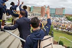 Sep 8, 2018; Morgantown, WV, USA; West Virginia Mountaineers quarterback Will Grier (7) waves to the WVUI Children's Hospital as he arrives at the stadium before their game against the Youngstown State Penguins at Mountaineer Field at Milan Puskar Stadium. Mandatory Credit: Ben Queen-USA TODAY Sports