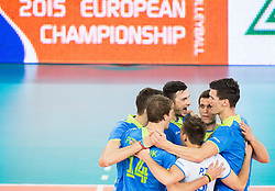 Players of Slovenia celebrate during volleyball match between National teams of Slovenia and Latvia in Qualifications for 2015 CEV Volleyball European Championship - Men on May 25, 2014 in Arena Stozice, Ljubljana, Slovenia. Photo by Vid Ponikvar / Sportida