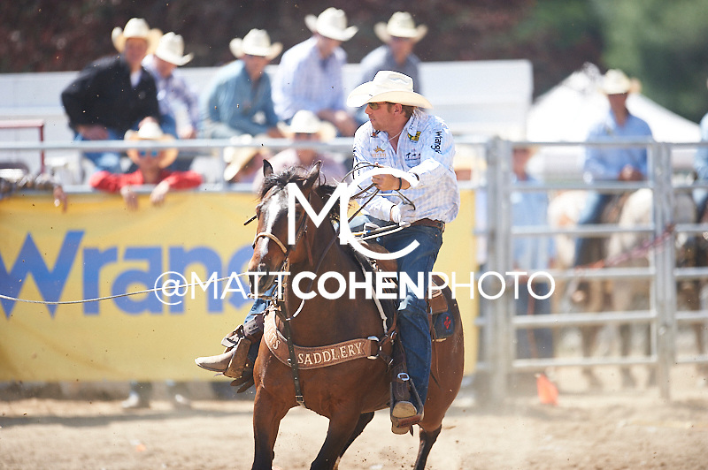 Team roper Spencer Mitchell of Colusa, CA competes at the Redding Rodeo in Redding, CA.<br /> <br /> <br /> UNEDITED LOW-RES PREVIEW<br /> <br /> <br /> File shown may be an unedited low resolution version used as a proof only. All prints are 100% guaranteed for quality. Sizes 8x10+ come with a version for personal social media. I am currently not selling downloads for commercial/brand use.