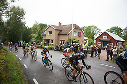 The break rides past a group of classical musician on the long loop of the Crescent Vargarda - a 152 km road race, starting and finishing in Vargarda on August 13, 2017, in Vastra Gotaland, Sweden. (Photo by Balint Hamvas/Velofocus.com)