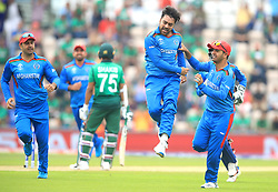 Afghanistan's Rashid Khan (centre) celebrates the wicket of Bangladesh's Shakib Al Hasan before it was overturned during the ICC Cricket World Cup group stage match at The Hampshire Bowl, Southampton.