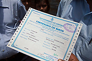 Children from the Dobhanda Nagar slum in Cuttack receive birth certificates from the Urban Law centre run by the organisation CLAP. Committee for Legal Aid to Poor (CLAP) helps provide legal aid to the poorer communities in the Orissa district of India.