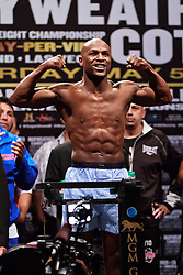 LAS VEGAS - MAY 4: Five-division world champion Floyd Mayweather Jr. and four-time world champion Miguel Cotto face off at the Mayweather vs. Cotto Weigh in at the MGM Grand Las Vegas, Nevada USA. All fees must be ageed prior to publication,.Byline and/or web usage link must read Eduardo E. Silva/SILVEX.PHOTOSHELTER.COM Failure to byline correctly will incur double the agreed fee.