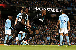 West Ham United's Angelo Ogbonna (centre) celebrates scoring his side's first goal of the game during the Premier League match at the Etihad Stadium, Manchester.