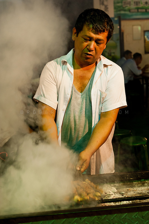 Food market at night, Turpan, Xinjiang, China