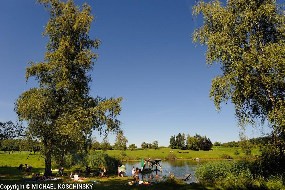 Summer in Switzerland: enjoying the pond.
