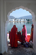 Women on the ghats by the holy lake, Pushkar, Rajasthan, India