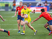 Australia player Ben O'Donnell looks to break a Spanish tackle in the game Australia vs Spain during the USA Sevens Rugby Series at Sam Boyd Stadium, Las Vegas, USA on 2 March 2018. Picture by Ian  Muir.