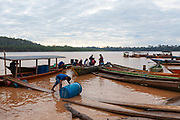 The miners come and go from their camps for the extraction of gold in the interior of the Amazon rainforest, they move through the Madre de Dios River in Boca Colorado, Peru.