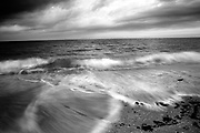 Seascape of Casey Key Florida beach at the Atlantic Ocean with a cloudy sunset. Black & White.