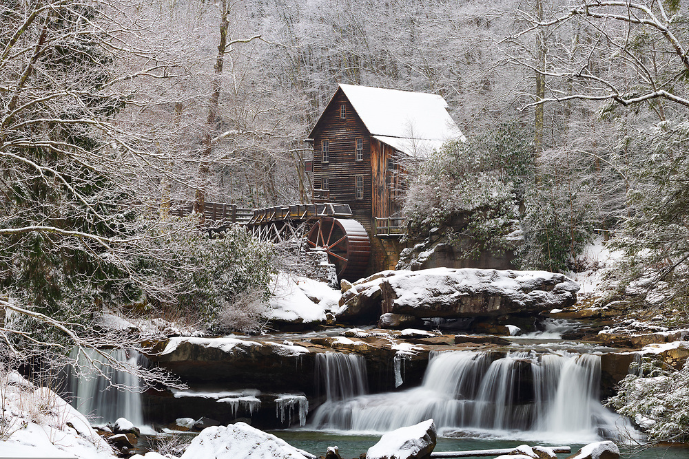 Winter, snow and ice fall over the iconic grist mill of Babcock State Park in West Virginia.