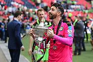 Forest Green Rovers goalkeeper Sam Russell(23) with the trophy during the Vanarama National League Play Off Final match between Tranmere Rovers and Forest Green Rovers at Wembley Stadium, London, England on 14 May 2017. Photo by Shane Healey.