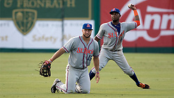 July 7, 2017 - Jupiter, Florida, U.S. - St. Lucie Met left fielder Tim Tebow is backed up by centerfielder John Mora after Tebow dived for a line drive hit by Jupiter Hammerheads Boo Vazquez at Roger Dean Stadium in Jupiter, Florida on July 7, 2017. (Credit Image: © Allen Eyestone/The Palm Beach Post via ZUMA Wire)