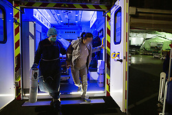 The patient is on oxygen bottle with a respirator in an ambulance for transportation to the hospital. Orane and Nicolas, members of the Protection Civile wearing personal protection equipment (PPE) in Paris takes care of a asian women suspected of being infected by the coronavirus during an intervention. French first aid workers from the Protection Civile Paris Nicolas, Orane and Quentin takes care of Covid cases at their home as they are doing a guard by night to help the SAMU, They handle cases suspected being infected with the novel coronavirus at their home. Paris on April 19, 2020 during a lockdown in France to stop the spread of the COVID-19. France has been on lockdown since March 17 in a bid to limit the contagion caused by the novel coronavirus. Photo by Raphael Lafargue/ABACAPRESS.COM