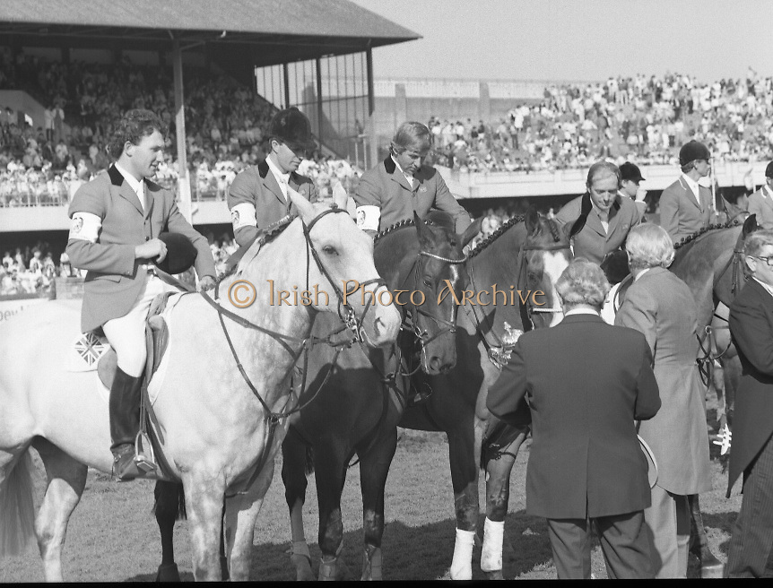 Dublin Horse Show (Aga Khan Cup).1986..08.08.1986..08.08.1986..8th August 1986..The annual Aga Khan Cup competition was held in the R.D.S. Dublin.Four countries competed for the cup this year.FDR Germany,The USA,Great Britain and Ireland. Great Britain were the eventual winners...Pictured congratulating the winning Great Britain team is  Mr Frank O'Reilly,Chairman of the RDS Executive Committee accompanied by the Chef d'Equipe of Great Britain, Mr Ronnie Massarella..The team consisted of (L-R) Peter Charles aboard April Sun, Michael Whitaker aboard Warren Point, Nick Skelton aboard Raffles Apollo and John Whitaker aboard Next Ryans Son.