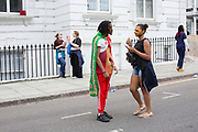 People congregate at Ladbroke Grove during the Notting Hill Carnival on the 27th August 2018 in London in the United Kingdom. The Notting Hill Carnival is an annual event held over two days of the August Bank Holiday weekend. It has taken place in London since 1966 on the streets of Notting Hill, in the Royal Borough of Kensington and Chelsea and the City of Westminster.