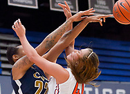 Fullerton, CA - NOVEMBER 07:  Portia Neale (44) of Cal State Fullerton attempts to block a pass made by Darsha Burnside (22) of California Baptist during a women's basketball game on November 7, 2014 in Fullerton, California.  Mandatory Copyright Notice: Copyright 2014 (Photo by Sarah Sachs)