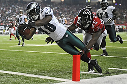 ATLANTA, GA - SEPTEMBER 18: Wide Receiver Jeremy Macklin #18 of the Philadelphia Eagles dives for a touchdown past  William Moore #25 of the Atlanta Falcons at the Georgia Dome on September 18, 2011 in Atlanta, Georgia . (Photo by Drew Hallowell/Philadelphia Eagles/Getty Images) *** Local Caption ***  Jeremy Maclin; William Moore